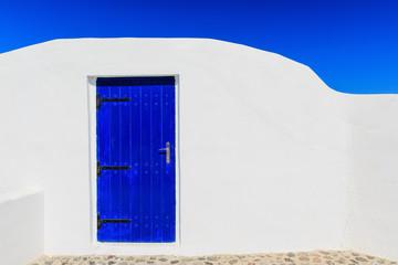 Wall Mural - Blue door & white wall, Santorini Greece