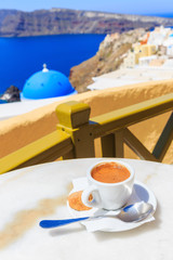 Fototapete - Coffee in Santorini, Greece