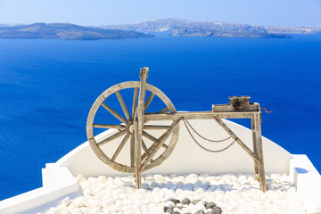 Fototapete - Roof decoration at the village of Oia in Santorini, Greece