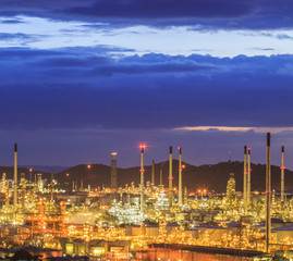 Oil refinery with sunset sky
