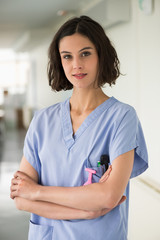 Portrait of a female nurse standing with her arms crossed