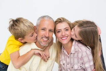 Happy family smiling and showing affection