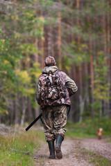 Door stickers Hunting hunter walking on the road