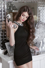 Beautiful brunette sensual girl model with luxury telephone rece