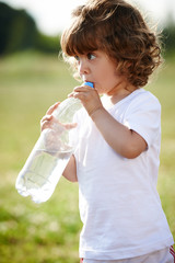 little girl drinking clean water from bottle