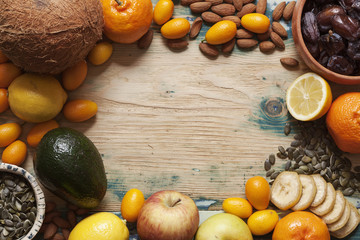 Fruit, nuts and seeds on rustic table