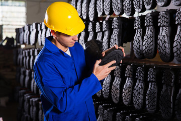 quality controller checking rubber-boots sole