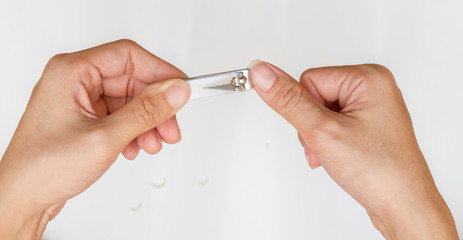 woman cutting thumb nail.