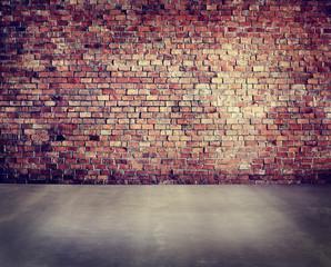 Empty Brick Wall with Concrete Floor