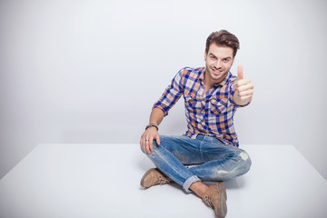 fashion man smiling and showing the thumbs up gesture