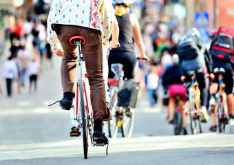 Fototapete - Bikes in traffic, diversified crowd