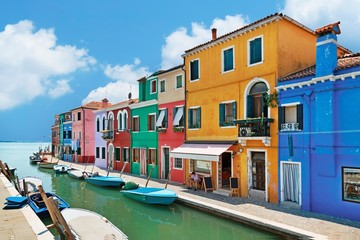 colorful houses by the water canal at the island Burano
