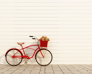 red retro bicycle with basket and flowers