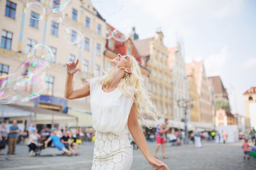 Alluring blonde having a grat fun with the soap bubbles