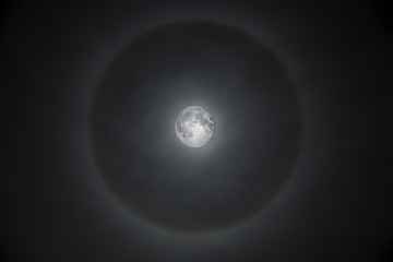 Magnificent full moon with misty halo