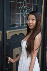 Asian woman opening a door