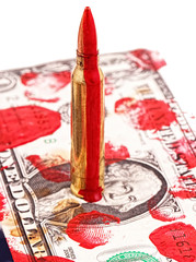 A cartridge with blood on a bill