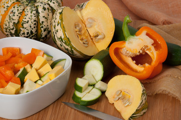 Organic Harlequin Squash. Zucchini. Paprika. Wooden Board