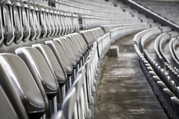 Fotorollo Stadion some rows of gray stadium seats, shoot from the side