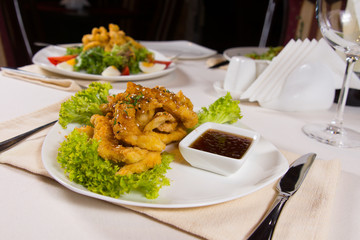 Plate of Sesame Chicken on Restaurant Table