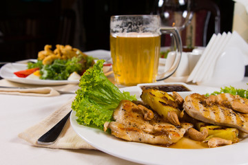 Appetizing Dishes and Beer Mug on Table