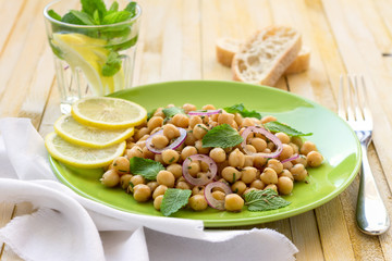 Vegetarian chickpeas salad with mint and spices