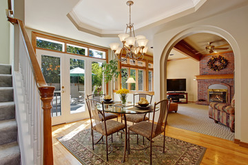 Bright dining area with walkout patio in luxury house