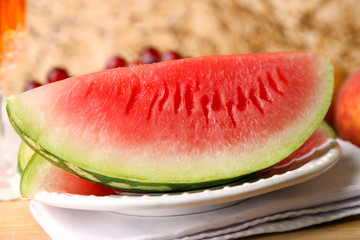 Composition of ripe watermelon, fruits, pink wine in glass