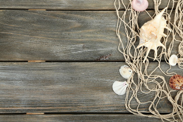 Decor of seashells wooden table background