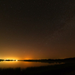 Smooth surface of the lake on a background the starry sky