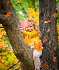 Cute baby girl in autumn forest