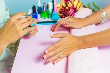 Manicure process in beauty salon, close up