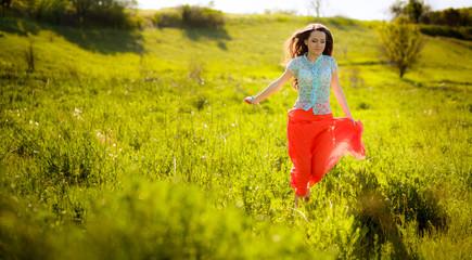 beautiful girl running on meadow