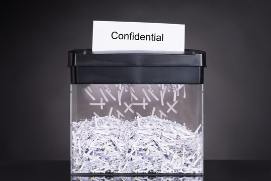 Shredded destroying confidential document