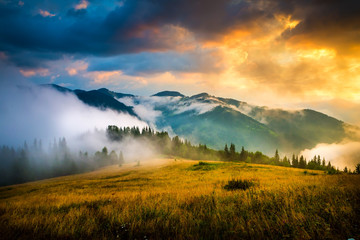 Amazing mountain landscape with fog and a haystack Fototapete