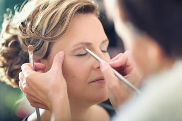 woman on cosmetics