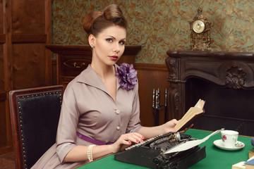 Pin Up woman in vintage interior prints on a typewriter