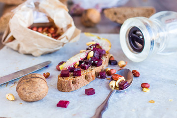 sandwich with roasted beets, nuts, pear and sesame