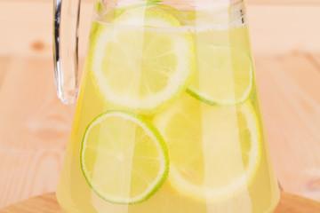 Fresh lemonade on the wooden desk