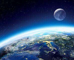 Obraz Widok ziemi i księżyca z kosmosu w nocy - fototapety do salonu