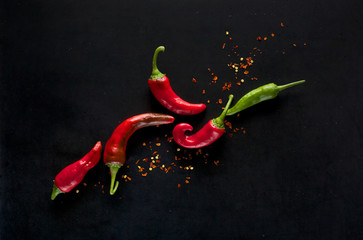 Chili peppers on a black background