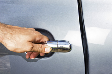 man hand opening a car door