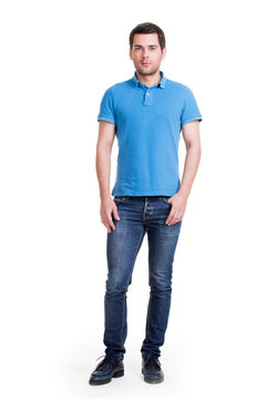Full portrait of smiling happy handsome man in blue t-shirt.