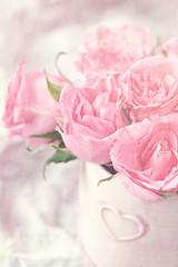 fresh pink roses in a ceramic vase