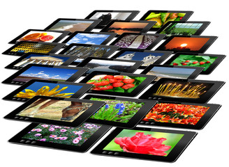 black tablets with motley pictures isolated