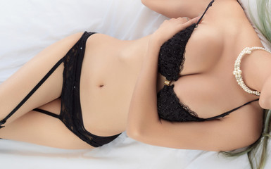 Young beautiful tanned Sexy Asian woman wearing elegant lingerie