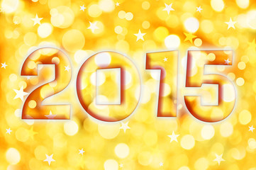 2015 greeting card on golden shiny holiday lights background