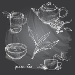 Hand drawn sketch vector tea set on blackboard.