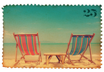 Vintage stylized postage stamp with two beach chairs