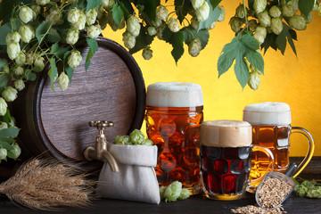 Vintage beer barrel with two beer glasses